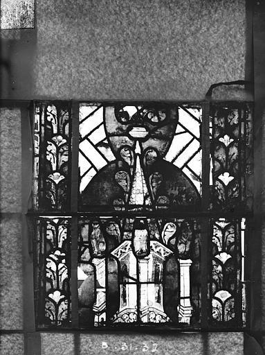 Eglise Saint-Gengoult Vitrail du transept nord, fenêtre B, 4ème lancette, panneaux au dessus 31, 32, Romanais (photographe),